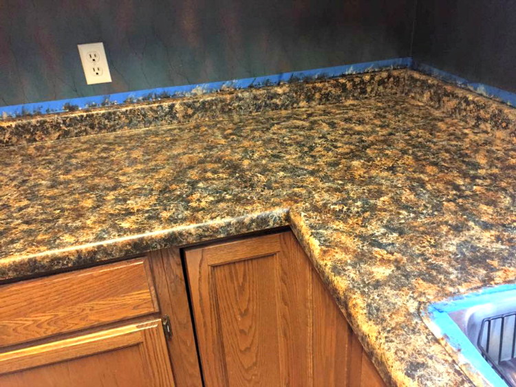... his wife loved the new look of their countertops using Giani Granite